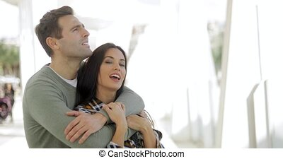 Loving young couple sharing a quiet moment standing in a...