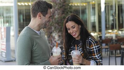 Happy relaxed couple enjoying takeaway coffee - Happy...