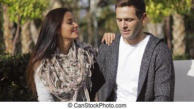 Happy young couple enjoying the autumn sunshine