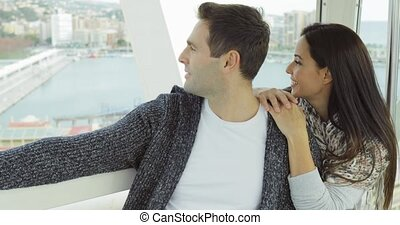 Couple sightseeing on a cable car or ferris wheel - Young...