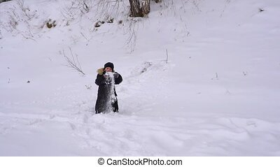 Boy teenager throws up fresh snow. The boy very happy the...
