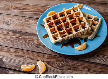 Belgian waffles on blue plate - Photo of Belgian waffles on...