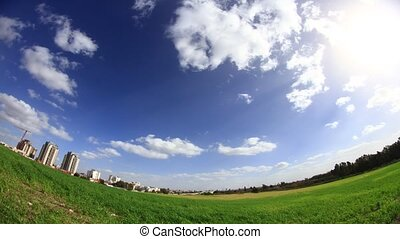 time lapse fisheye lens wheat field buildings and clouds