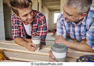 Two men had conversation while drinking coffee