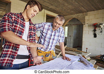 Younger of carpenters is demonstrating new idea