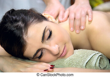 Beautiful woman getting back massage in spa happy relaxing closeup