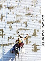 Building industrial worker hanging