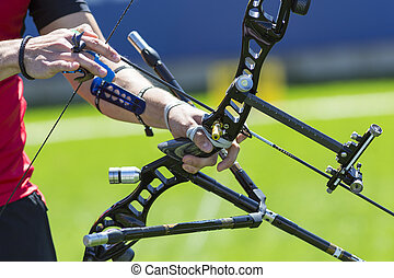 Bow shooting hands only - A man is shooting with a recurve...