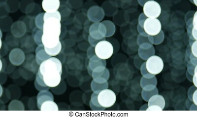 Moving particles, blurred, bokeh lights background. Abstract sparkles.
