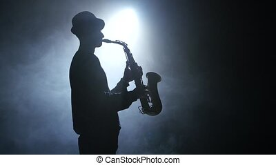 Solo concert of the actor playing on the saxophone. Smoke -...