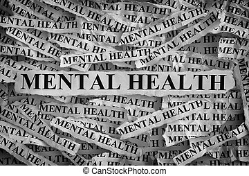 Mental health. Torn pieces of paper with the words Mental...