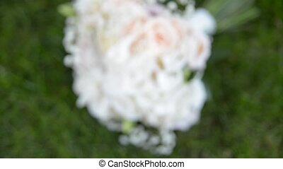 wedding rings on a bouquet close-up shoot