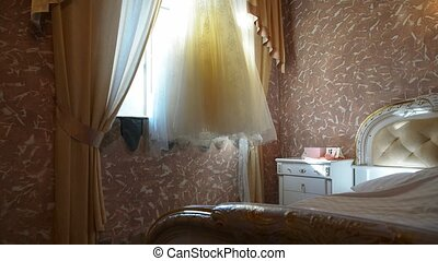 beautiful wedding dress in a hotel room
