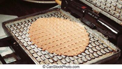 Preparing homemade waffles, frying a dough. Waffle iron in...