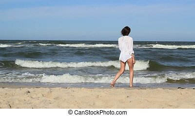 Girl At The Beach - Static footage with a nice girl at the...