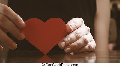 Red heart in the woman hand side view, concept footage for...