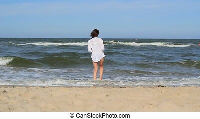 Girl At The Beach Walking Through Sea Water - Static footage...