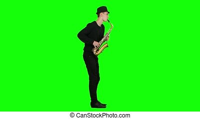 Blues melodies performed by young musician on the saxophone....