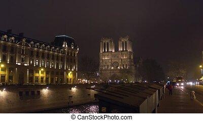 Western facade of famous Notre Dame de Paris cathedral...