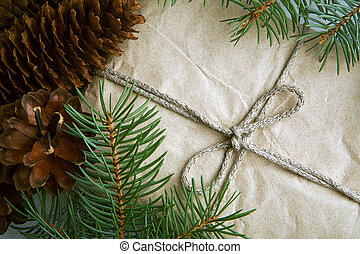 Christmas craft gift with cones and fir branches - Gift...