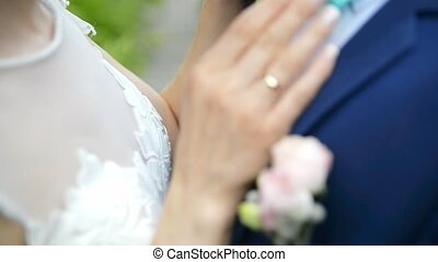 couple hands embracing on wedding day - couple embracing on...