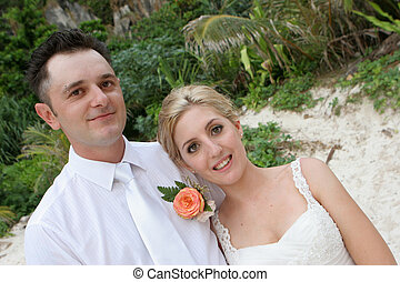 Bride and groom on the beach on their wedding day.