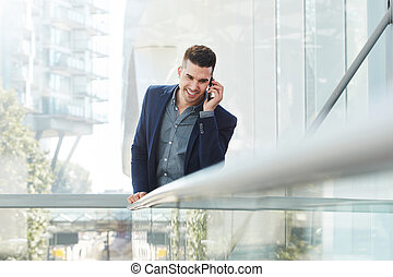 smiling young business man listening with cellphone