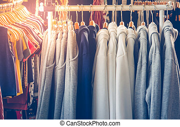 sweaters - Sweaters Hanging on Metal Clothes Rack