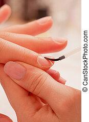 Manicure treatment - applying base coat - Applying base coat...