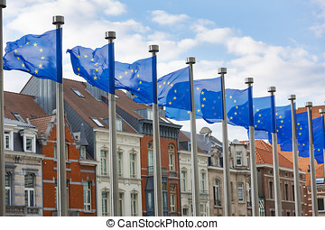 EU Flags Flying in Front of Traditional Houses in Brussels -...