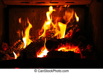 Burning wood in the fireplace - Burning pieces of wood in...