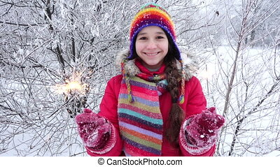 Girl with sparlkes on winter forest, slow motion