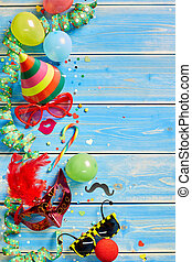 Colorful party objects over blue wooden background - Various...