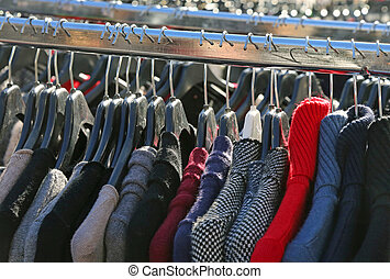 many winter hanging clothes for sale in the market