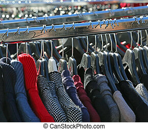 winter clothes for sale in the outdoor market - many winter...