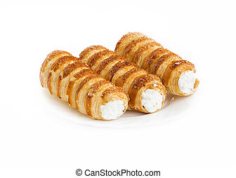 Cream rolls pastry isolated - Cream rolls pastry. Horns...