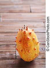 Kiwano fruit on brown wooden table