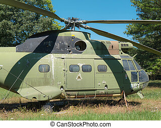 Wreck of old military helicopter - the wreck of a old...