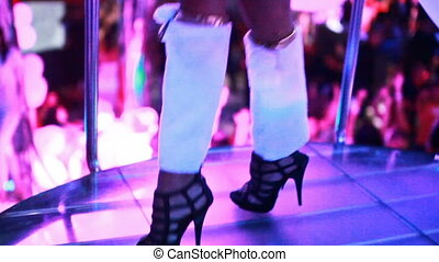 Legs of PJ girl, dancing at the nightclub