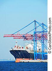 Port cargo crane, ship and container over blue sky...
