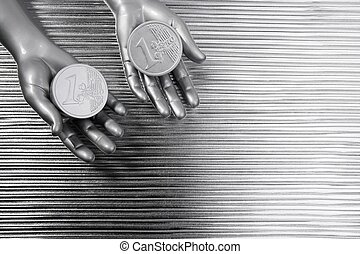 two silver euro coins in futuristic robot hands - two silver...