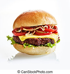 Close up of thick and juicy cheese burger on a plain bun...