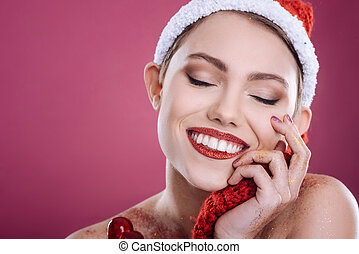 Pleasant smilig woman posing against pink background - Full...
