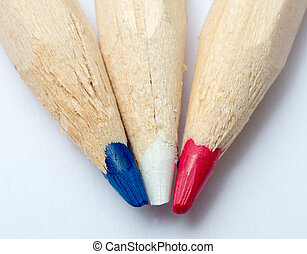 three colored pencils, blue, white, red