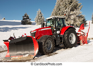 Red tractor for snow removal in french Alps
