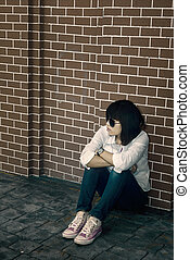 Lonely Woman - Lonely woman in white shirt on the wall