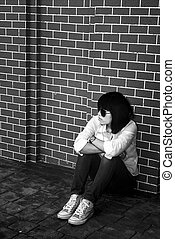 Lonely Woman - Lonely woman in white shirt on the wall,...