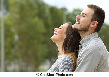 Couple breathing fresh air in a park