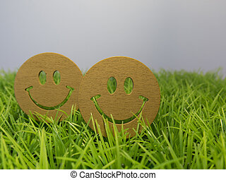 The two emotions of joy on the green grass, summer fun background about the nature and relax