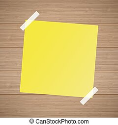 Yellow note leaf from a notebook taped on the wooden background